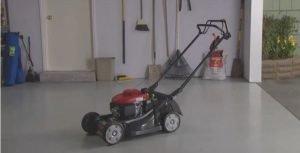 lawn mower storage in garage