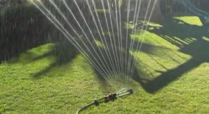 Oscillating sprinkle system for lawn